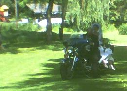 Only in Wisconsin does the Bride arrive on a Harley Davidson...