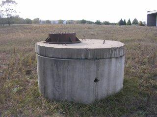 Sewer cap in a field